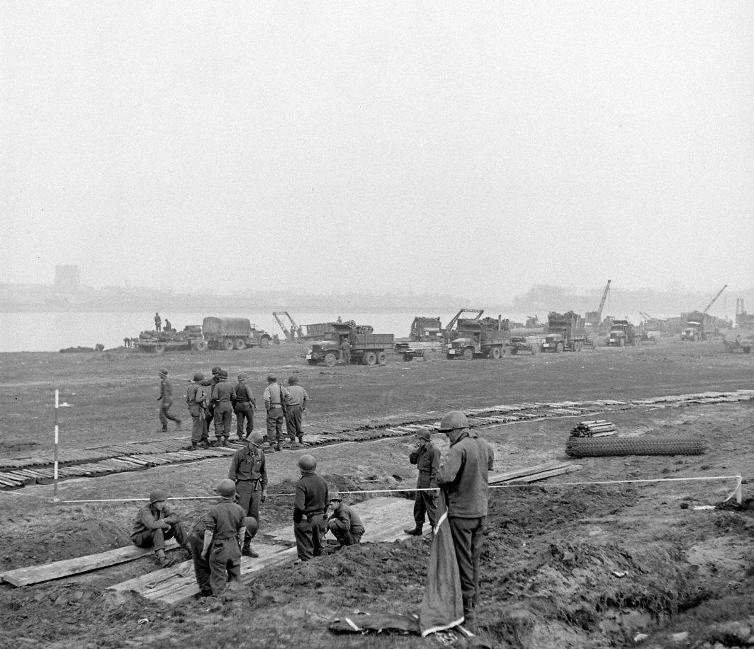 Brockway B666 6x6 trucks of 17th Armored Engineers in the background.