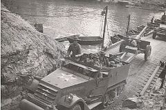 An armored car, half-track of the 78th FA passes over the bridge built by the 17th Engineers across the Sabine River
