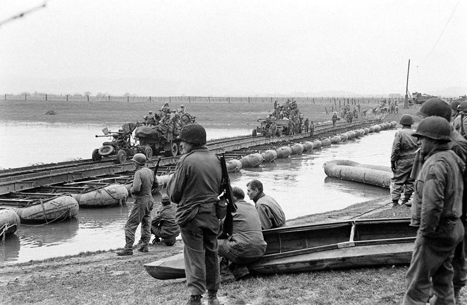 The Weser river, members of 17th Armored Engineers watch elements from the Division cross the Bridge they constructed