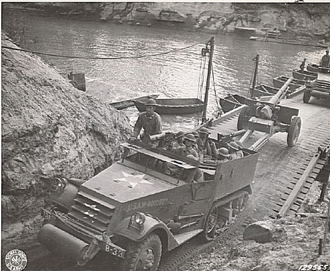 An armored car, half-track of the 78th FA passes over the bridge built by the 17th Engineers across the Sabine RiverAn armored car, half-track of the 78th FA passes over the bridge built by the 17th Engineers across the Sabine River