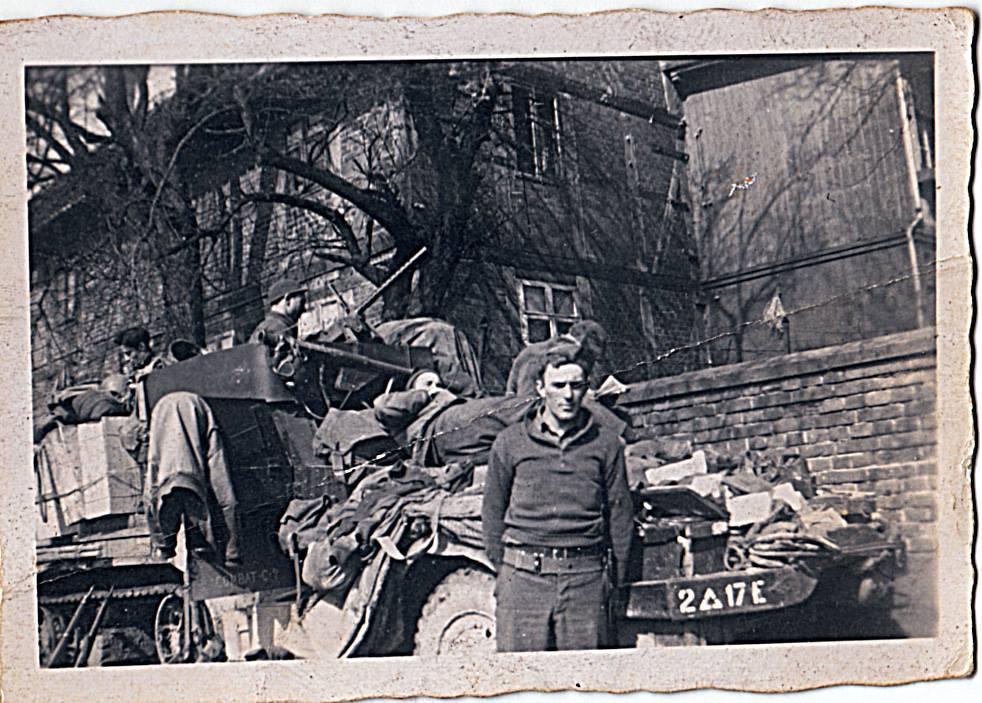David E. (Edd) Hiett's, halftrack. Germany, January 1945. He is on top cleaning his .50 caliber machine gun