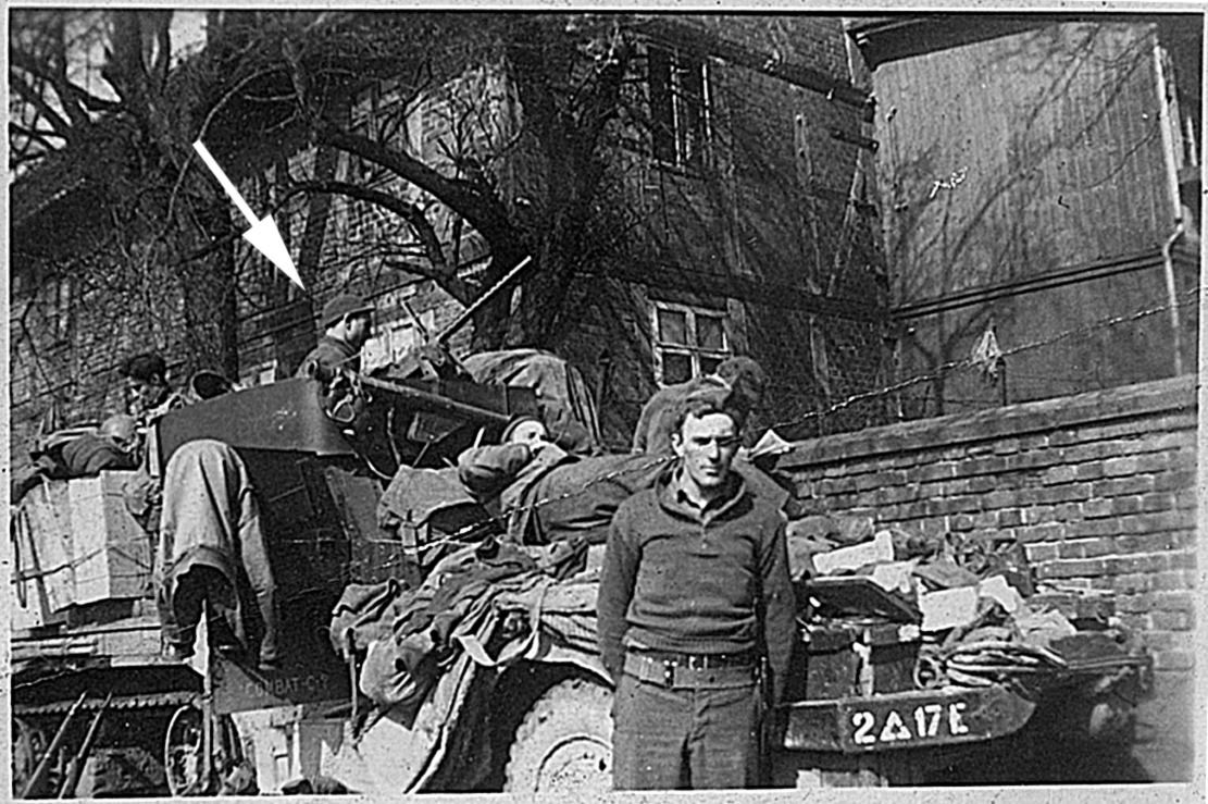 Edd Hiett's halftrack of Company C, 17th Engineers, 2nd Armored Division in 1945. He is on top cleaning his .50 caliber machine gun, mounted in front of him is a bazooka.