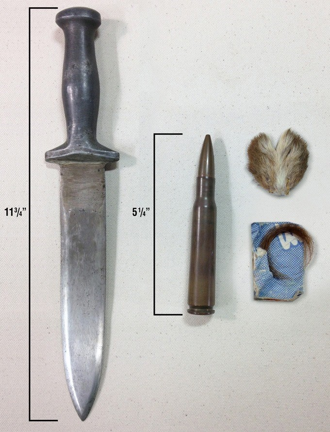 Edd Hiett's knife he carried during the War that his brother made for him, a .50 caliber bullet from his machine gun, a lucky rabbit's foot and a lock of my mother's hair.