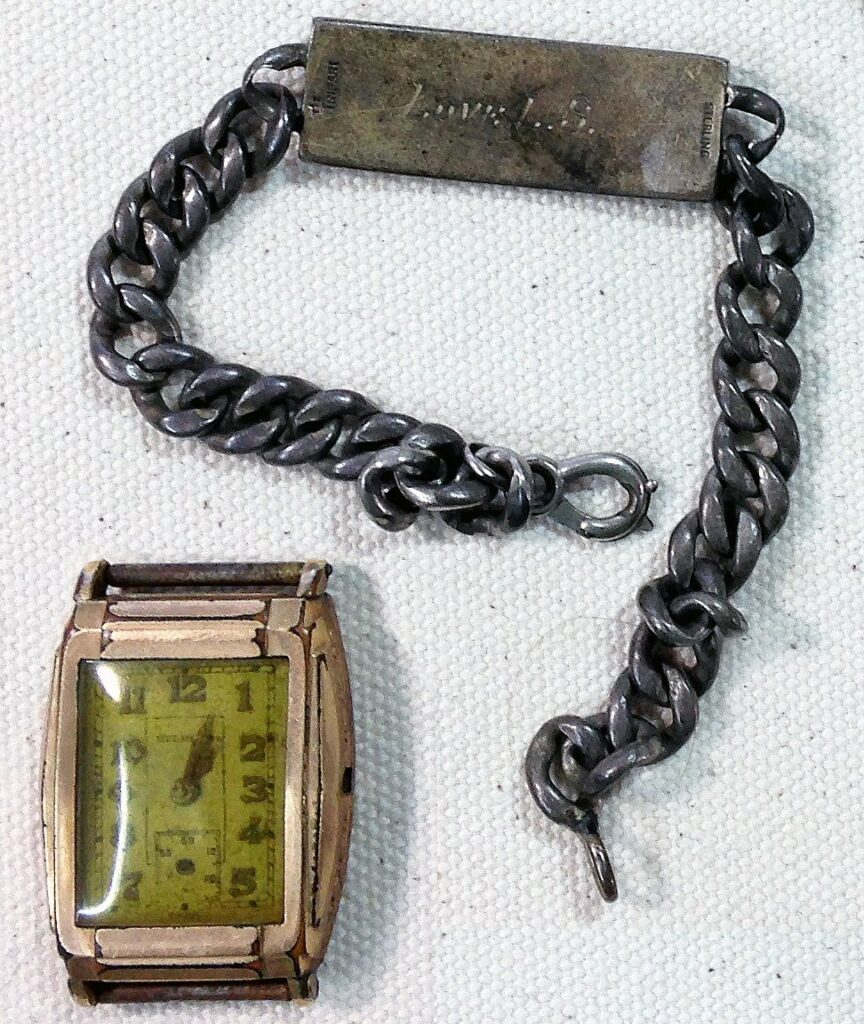 The watch and bracelet mentioned in the letter, The watch stopped at about 4 minutes past 1pm when the explosion blew him into the water. (Courtesy Mark Hiett)
